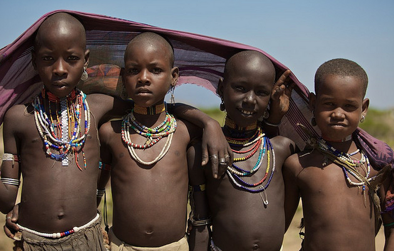 Sharing one scarf-Arbore Kids, Omo Valley Ethiopia